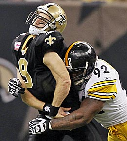 This 'a little late' hit on Drew Brees might earn Harrison another fine. (AP)