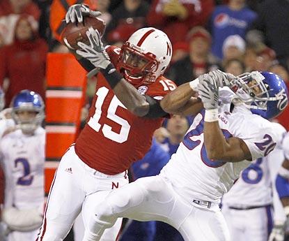 Nebraska cornerback Alfonzo Dennard intercepts a pass intended for Kansas running back D.J. Beshears in the second half.  (AP)