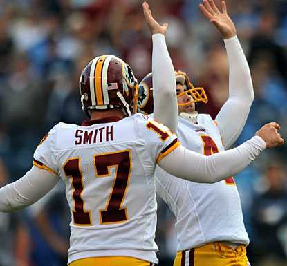 Redskins kicker Graham Gano raises his hands in victory after nailing a 48-yard, game-winning field goal in overtime.  (US Presswire)