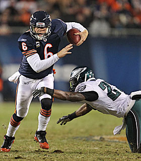 Jay Cutler makes like Michael Vick, scrambling against the Eagles. (Getty Images)