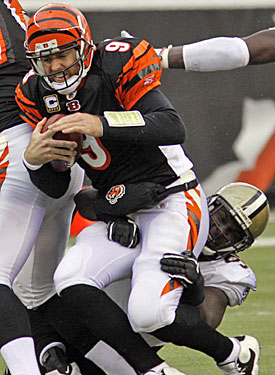 The numbers say Carson Palmer had a decent game, but once again he helps the Bengals do everything but win. (AP)