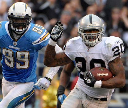The Chargers can't catch up to Darren McFadden -- who rushes for 97 yards and a touchdown for the resurgent Raiders.   (US Presswire)