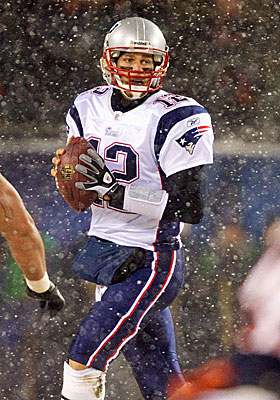Tom Brady throws for 369 yards and two touchdowns in the snow. (Getty Images)