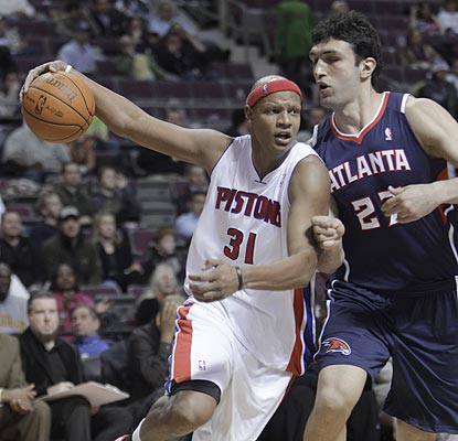Charlie Villanueva, shown driving around Atlanta's Zaza Pachulia, comes off the bench to score 23 points on 10-of-17 shooting.  (AP)