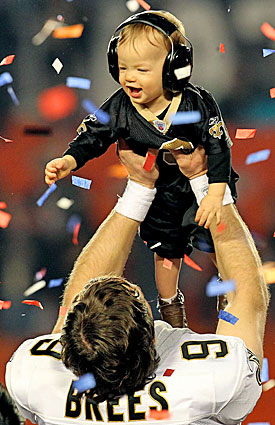 Saints fans, football fans, non-fans -- all will remember Drew Brees hoisting son Baylen after the Saints' Super Bowl victory. (Getty Images)