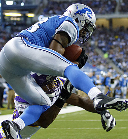 The Lions' Nate Burleson makes a seven-yard catch in the second quarter against the Vikings. (AP)