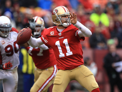 Alex Smith prepares to gun the ball downfield as he leads the 49ers to an easy win over the Cardinals.  (Getty Images)