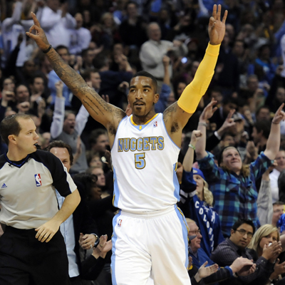 J.R. Smith scores a game-high 28 points while leading the Nuggets to a one-sided victory over the James-less Heat.  (US Presswire)