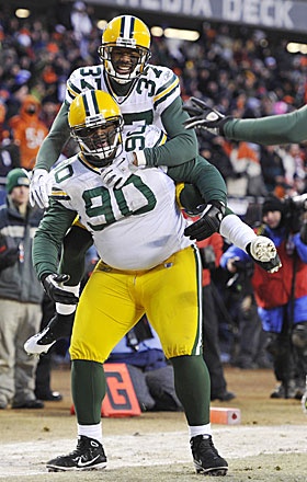 B.J. Raji is joined by Sam Shields in celebrating Raji's clinching TD at Soldier Field. (AP)