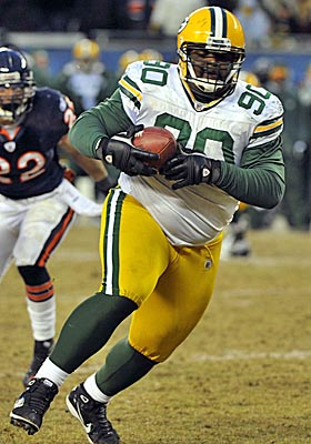 B.J. Raji rumbles for a touchdown return after picking off Caleb Hanie in the fourth quarter of Sunday's NFC title game. (US Presswire)