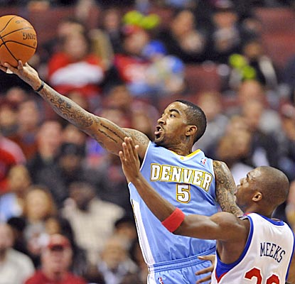 J.R. Smith drives past Jodie Meeks for two of his 23 points in the loss to the Nets. (US Presswire)