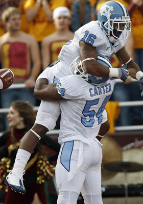 Kendric Burney (top) may have less-than-ideal size and Bruce Carter has to overcome injuries. (US Presswire)