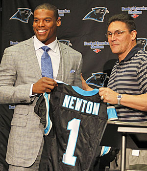 Cam Newton might be asking Panthers rookie coach Ron Rivera for a different number. (AP)