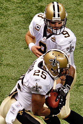 Drew Brees, a veteran of similar situations, is trying to convince Reggie Bush the Saints' move is good for him. (Getty Images)