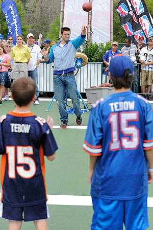 Tim Tebow is working hard to make sure all the kids wearing his jersey get to display the name of a starting NFL quarterback. (Getty Images)