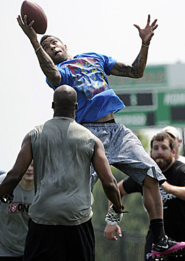 Falcons safety Thomas DeCoud hauls in an interception during a player-organized workout in Buford, Ga. (AP)