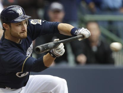 Jonathan Lucroy lays down a suicide squeeze in the ninth to give the Brewers a one-run win over the Giants.   (Getty Images)