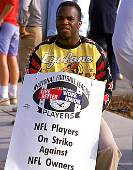 A member of the L.A. Raiders sits in a picket line during the strike of 1987. (Getty Images)
