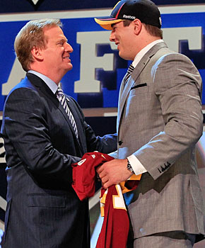 Roger Goodell, getting chummy at the draft with Redskins pick Ryan Kerrigan, isn't really an ogre. (Getty Images)