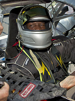 Chad Ochocinco's gimmicks have included NASCAR laps, bull riding and a soccer dalliance. (AP)