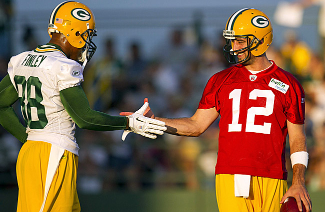 Aaron Rodgers (right) congratulates Jermichael Finley after a play during Packers training camp. (US Presswire)