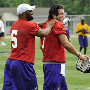 McNabb, joking around with rookie quarterback Christian Ponder, says he doesn't look at himself 'as a security blanket.' (AP)