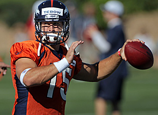Vying for the starting job in Denver, Tim Tebow is famous for ignoring critics: 'Others who say I won't make it are wrong.' (Getty Images)