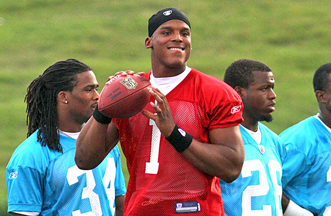 The Panthers spent millions re-signing core players, but drafting Cam Newton topped their wish list. (US Presswire)