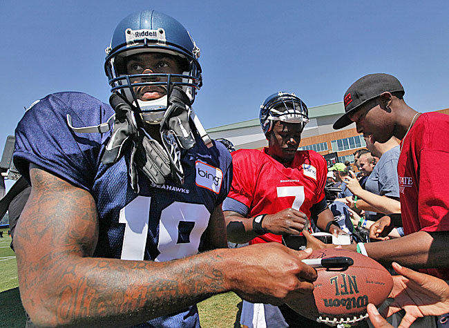 Sidney Rice and Tavaris Jackson are on board in Seattle. But questions abound. (AP)