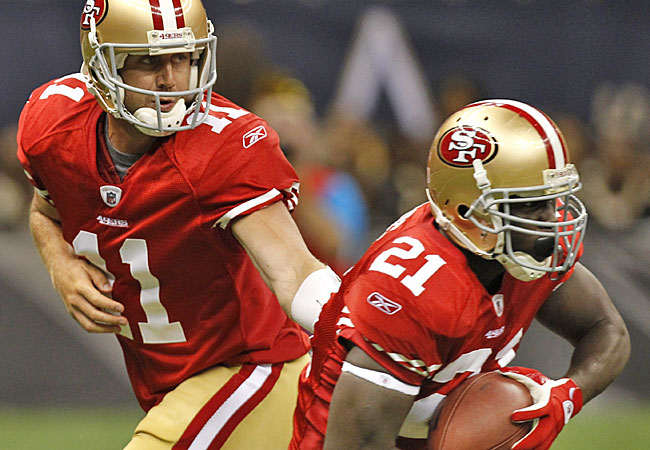 Alex Smith returns as the starter, hoping to have a healthy Frank Gore for a full season. (AP)