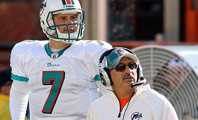 Survivors Chad Henne and Tony Sparano both spent lots of offseason time on the Miami hotseat. (Getty Images)
