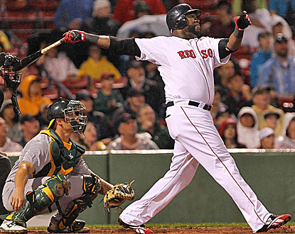 David Ortiz enjoys a banner day against Oakland, going 5 for 8, including this home run in Game 2. (Getty Images)