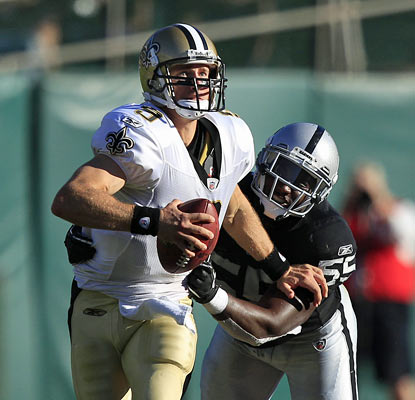 Rolando McClain and the Raiders struggle to contain Drew Brees, who finishes 12 of 23 for 189 yards in the first half. (AP)