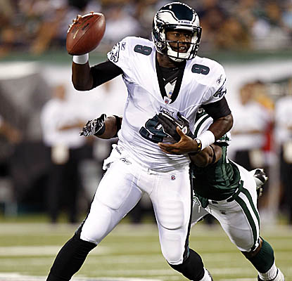 Starting for Michael Vick, backup QB Vince Young leads the Eagles on two scoring drives before his exit. (Getty Images)