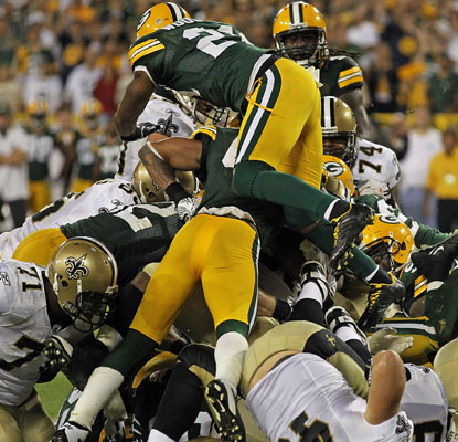 The Packers defense swarms to the ball to stuff Saints rookie Mark Ingram at the 1-yard line with no time left on the clock.  (US Presswire)