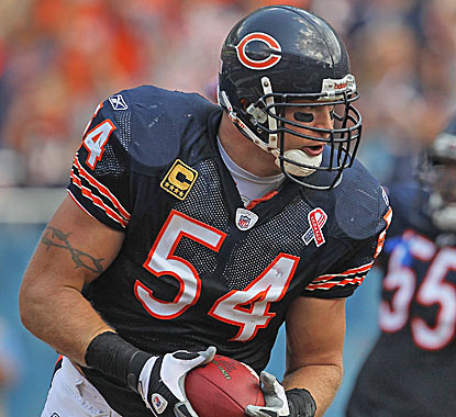 Brian Urlacher crosses the goal line with a recovered fumble, one of two turnovers he recorded against the Falcons. (Getty Images)