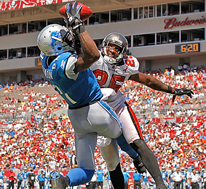 Detroit's Calvin Johnson outjumps Aqib Talib of the Buccaneers for one of his two touchdowns in the Lions' victory. (Getty Images)