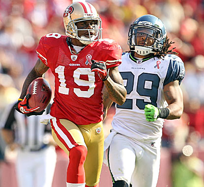 Ted Ginn Jr. outruns Earl Thomas of the Seahawks on his way to a 102-yard kickoff return in the fourth quarter. (Getty Images)