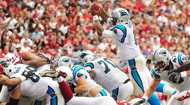 Newton has many impressive plays, including this leaping 1-yard touchdown. (US Presswire)