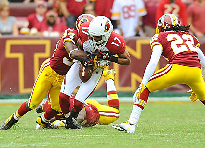 The Redskins' Byron Westbrook (left) forces a fumble by Chansi Stuckey (17), cementing the win.    (US Presswire)