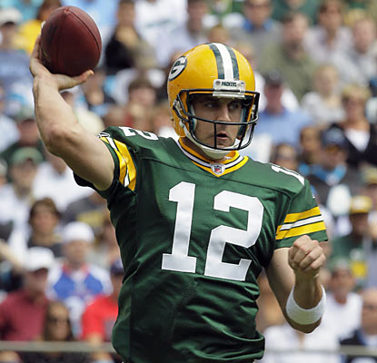 Aaron Rodgers of the Packers throws a pass in the second quarter against the Panthers.  (AP)