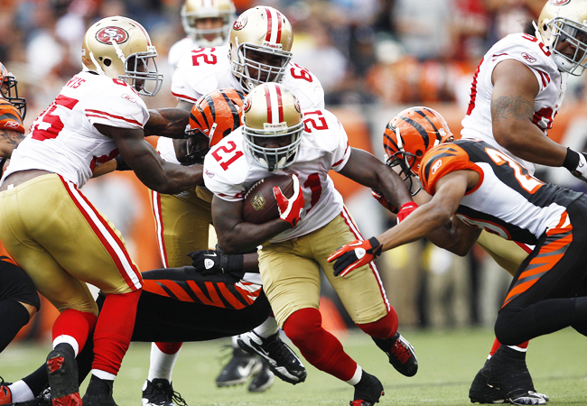 San Francisco RB Frank Gore carries the ball 17 times for 42 yards against the Bengals. (Getty Images)