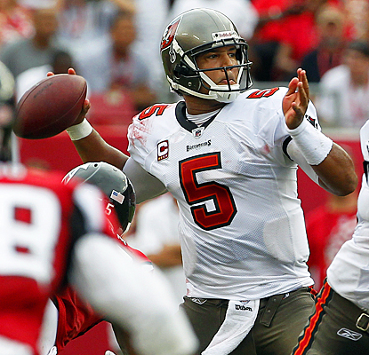 Josh Freeman fires a pass during the second quarter against the Falcons. (AP)