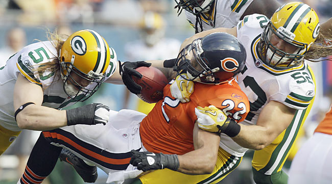 A.J. Hawk, Clay Matthews and the Packers D show their teeth against Chicago. (AP)