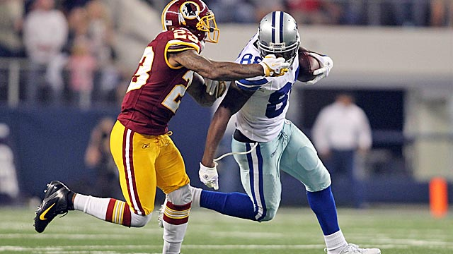 DeAngelo Hall grabs the facemask of the Cowboys' Dez Bryant in the fourth quarter. (US Presswire)