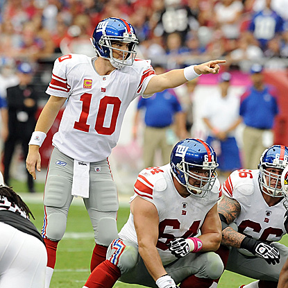 Eli Manning has a big game, throwing two touchdown passes in a 58-second span late in the game to beat the Cardinals. (AP)