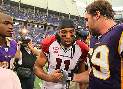 Larry Fitzgerald (only four catches, 66 yards) greets Jared Allen as Adrian Peterson looks on.  (Getty Images)