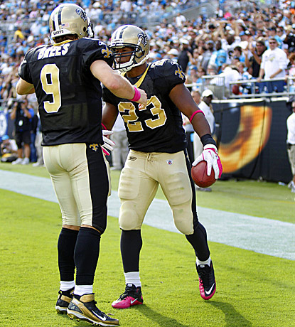 Pierre Thomas (right) celebrates after catching the game-winning touchdown from Drew Brees. (US Presswire)