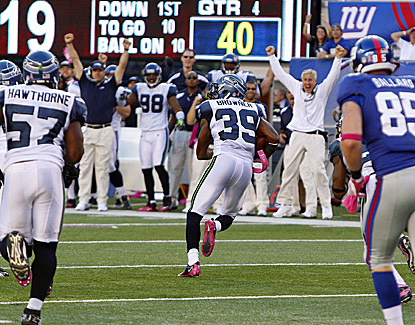 Seattle's Brandon Browner (39) runs in for the score after picking off New York's Eli Manning. (US Presswire)