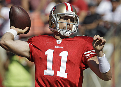 49ers quarterback Alex Smith goes 11 for 19 for 170 yards and three scores in a laugher against the Bucs. (AP)